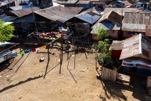 poor houses with sheet tin by the river Kota Manado North Sulawesi Indonesia