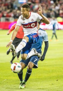 TFC #2 Justin Marrow goes airborne as Toronto met Vancouver Whitecaps. Despite Marrow's acrobatics, Vancouver won the game 4-3. Toronto fans rally for their team with a banner despite an eventual 4 to 3 loss while TFC -#17 Jozy Altidore and White Caps #26 Tim Parker chase the ball. Gerard Richardson photos.