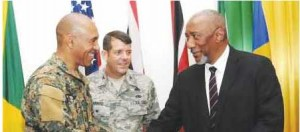 Major General Antony Bertram Anderson (left), Jamaica Defence Force, greets Francis Forbes, senior US military official and Col. Randall Warring of the US Air Force.