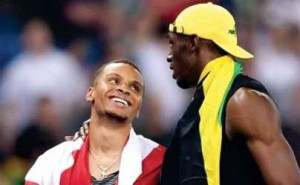 Track and field stars Usain Bolt and Andre De Grasse savor the moment of victory after the 100-meter dash at the Rio Olympics on Sunday.