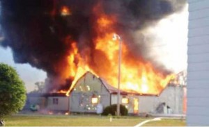 The farm workers living quarters go up in flames