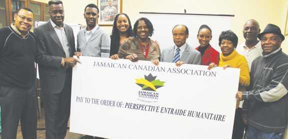 A BIG CHECK FOR HAITI